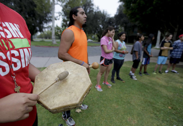 Native Americans join together in a drum circle at the University of California, Riverside. CHRIS CARLSON / Associated Press